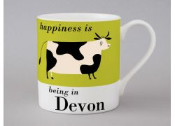 A bone china Devon cow mug by Repeat Repeat