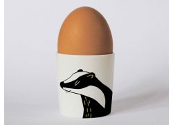 A bone china badger egg cup by Repeat Repeat