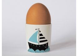 A bone china boat egg cup by Repeat Repeat