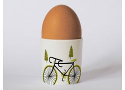 A bone china cycling egg cup by Repeat Repeat