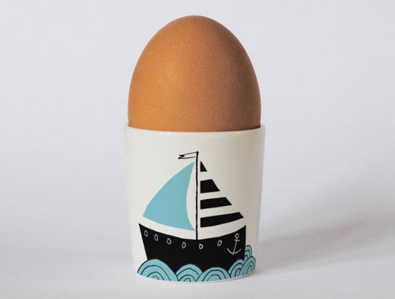 A bone china boats egg cup by Repeat Repeat