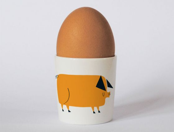A bone china pig egg cup by Repeat Repeat